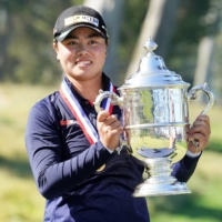 Yuka Saso hoists the U.S. Open trophy after winning in a sudden death playoff following the final round of the U.S. Women's Open golf tournament at The Olympic Club in San Francisco on Sunday.  | USA TODAY SPORTS / VIA REUTERS