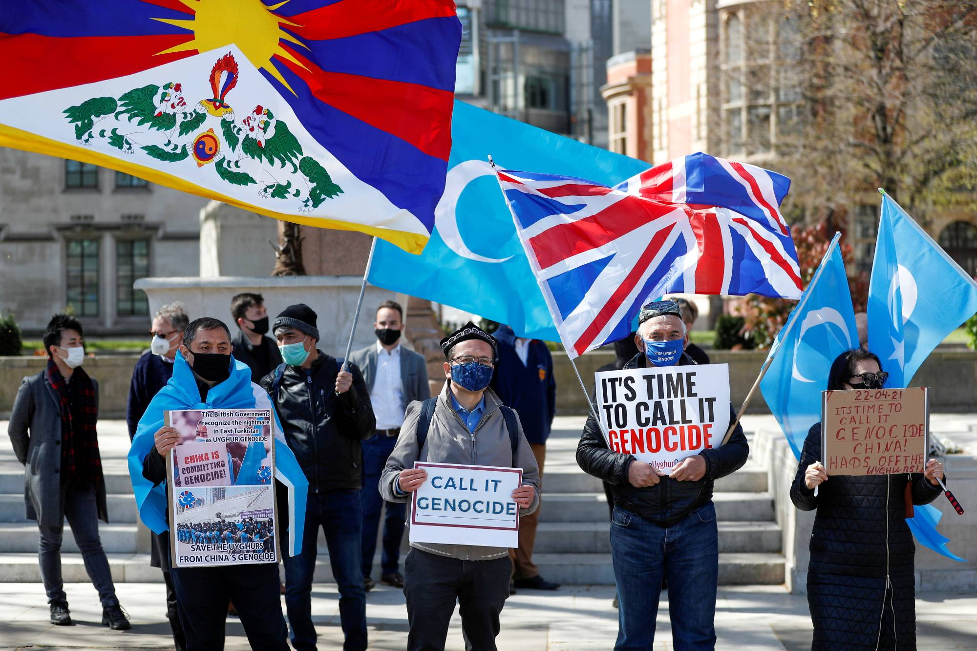Demonstrators stage a protest in London in April against China's treatment of Uyghurs. | REUTERS