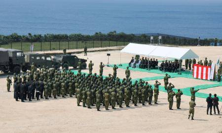 Ground Self-Defense Force personnel take part in a ceremony on Japan's westernmost island of Yonaguni, Okinawa Prefecture, in March 2016, to mark the establishment of a new GSDF unit on the remote island.   KYODO
