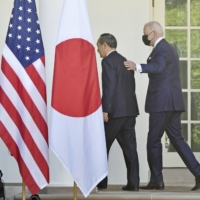 Prime Minister Yoshihide Suga and U.S. President Joe Biden issued a joint statement in April mentioning the importance of peace and stability across the Taiwan Strait.   KYODO