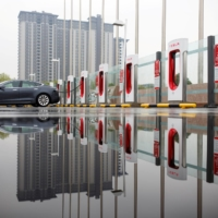 A Tesla car at a charging point in Beijing in 2018 | REUTERS