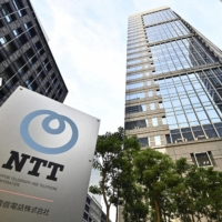 NTT cuts top executives' pay after scandal over meals with ministry officials