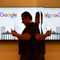 Facebook Inc., Amazon.com Inc. and Alphabet Inc.'s Google have paid effective tax rates which appeared on a long, steady march toward zero, much to the consternation of European governments in particular. | AFP-JIJI