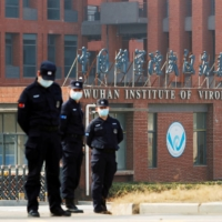 Security personnel keep watch outside the Wuhan Institute of Virology during a visit by a World Health Organization team in February.  | REUTERS