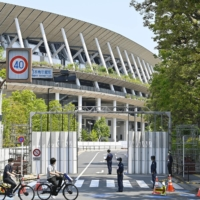 Roads around the National Stadium were closed off Tuesday in preparation for the Tokyo Summer Olympics, scheduled to open on July 23. | KYODO