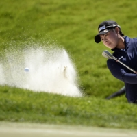 Yuka Saso plays a shot from a bunker on the third hole during the third round of the U.S. Women's Open in San Francisco on Saturday.   USA TODAY / VIA REUTERS