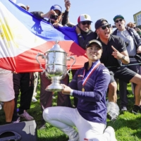 Yuka Saso's father moved her family to the Philippines in order to support her budding career as a golfer.   KYODO