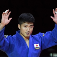 Joshiro Maruyama celebrates after winning the men's 66-kg final against Italy's Manuel Lombardo during the 2021 Judo World Championships on Monday in Budapest. | AFP-JIJI