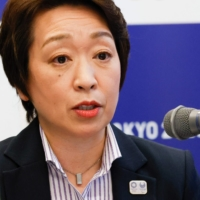 Tokyo 2020 President Seiko Hashimoto said Tuesday that visiting journalists covering the Tokyo Olympics will be closely monitored via GPS. | POOL / VIA AFP-JIJI