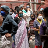 People wait to receive their second doses of Covishield in Kolkata, India, last month. | REUTERS