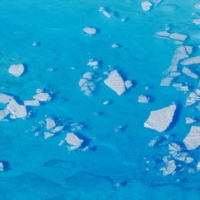 Chunks of ice float inside meltwater pools on top of a glacier near Tasiilaq, Greenland, in 2018.  | REUTERS