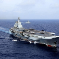 China's Liaoning aircraft carrier takes part in a military drill in the western Pacific Ocean in April 2018.  | REUTERS