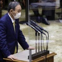 Prime Minister Yoshihide Suga speaks during a committee session at the Upper House in Tokyo on Monday.