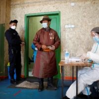 Mongolians head to polls in pandemic-curbed election