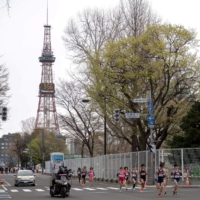 Athletes compete in a half-marathon race which doubles as a test event for the 2020 Tokyo Olympics, in Sapporo, on May 5. | POOL / VIA REUTERS