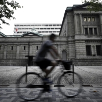 The Bank of Japan is seen keeping in place its negative interest rate and asset purchase settings at next week's meeting, a survey shows. | BLOOMBERG