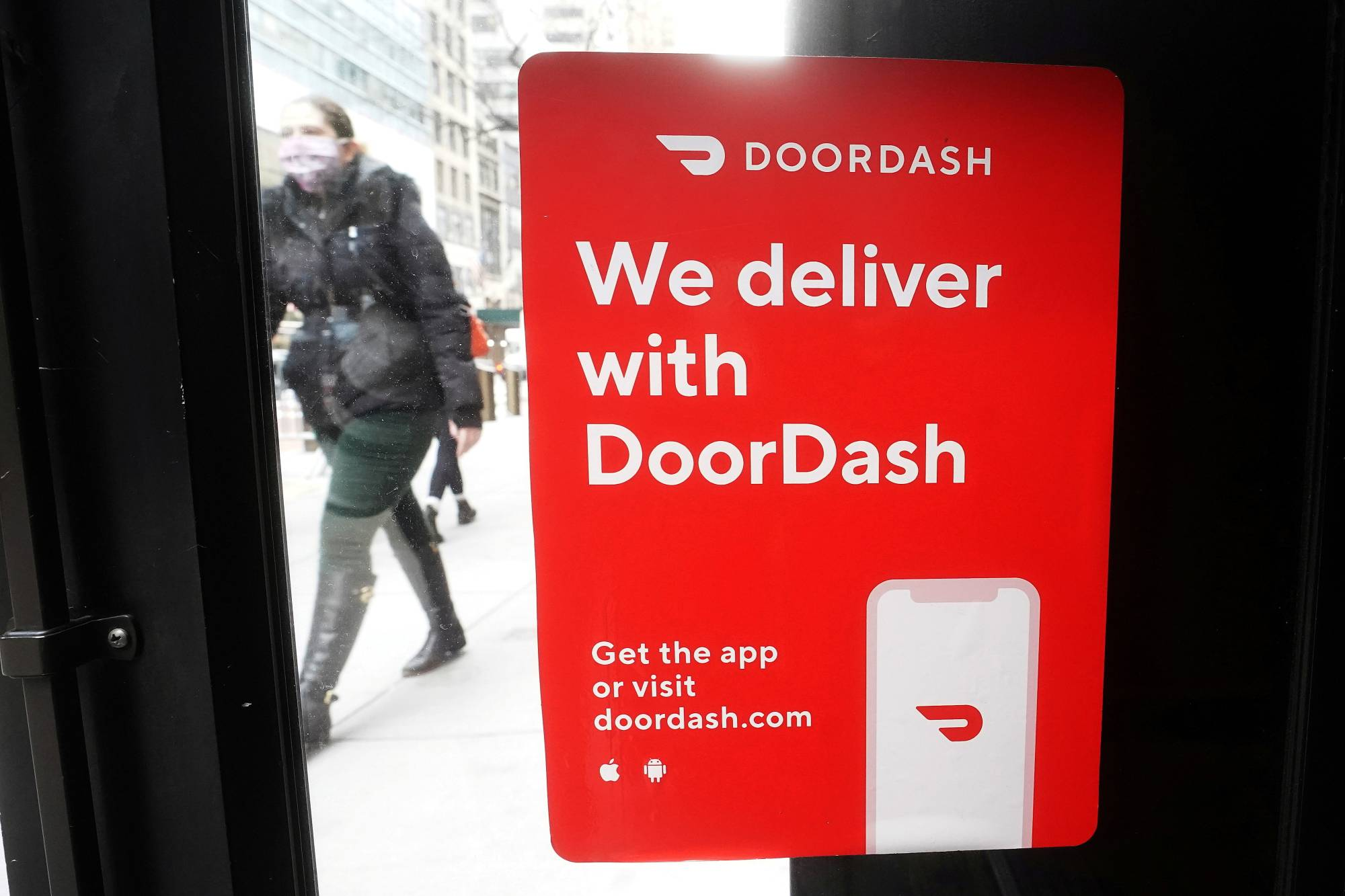 A DoorDash sign is put up on a restaurant in New York.    REUTERS
