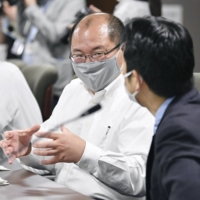 Kyoto University professor Hiroshi Nishiura attends a meeting of the health ministry's expert panel on Wednesday in Tokyo.   KYODO