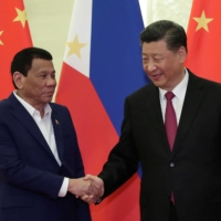 Chinese President Xi Jinping meets with Philippine President Rodrigo Duterte at the Great Hall of People in Beijing in April 2019.     POOL / VIA REUTERS