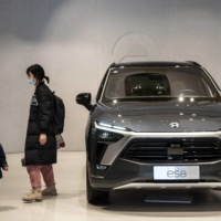 A Nio Inc. ES8 electric vehicle at a Nio House in Shanghai. Nio's business model relies on creating a sense of allegiance among buyers, who then persuade friends and family to spread the word about its cars. | BLOOMBERG