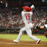 The Los Angeles Angels' Shohei Ohtani hits a double in the seventh inning against the Arizona Diamondbacks at Chase Field in Phoenix on Friday.  | USA TODAY / VIA REUTERS