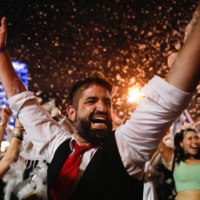 People celebrate after Israel's parliament voted in a new coalition government, ending Benjamin Netanyahu's 12-year hold on power, at Rabin Square in Tel Aviv on Sunday.  | REUTERS