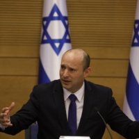Naftali Bennett, Israeli's new prime minister and leader of the Yamina party, speaks during a meeting of the new government at the Knesset in Jerusalem on Sunday.  | BLOOMBERG