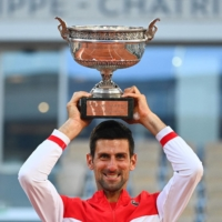 Novak Djokovic rallies from two sets down to edge Stefanos Tsitsipas in dramatic French Open final