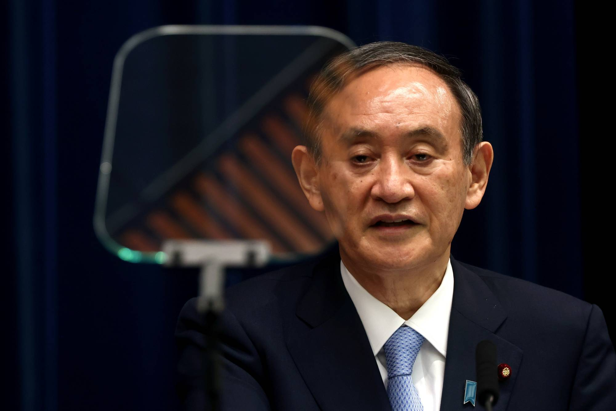 With the coronavirus running amok, public attention has focused on the government's measures against the pandemic, which have occupied much of Prime Minister Yoshihide Suga's time and energy. | POOL / VIA REUTERS