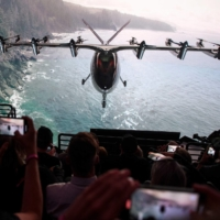 Attendees watch as the Archer Aviation Maker is unveiled on Thursday in Hawthorne, California. | AFP-JIJI