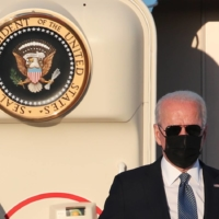 U.S. President Joe Biden gets off Air Force One after arriving at Brussels Military Airport in Melsbroek, Belgium, on Sunday ahead of a NATO summit. | POOL / VIA REUTERS
