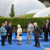 Group of Seven and European leaders greet the U.K.'s Queen Elizabeth II during a reception on the sidelines of the Group of Seven summit, at the Eden Project in Cornwall, England, on Friday. | POOL / VIA REUTERS