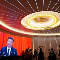 Chinese leader Xi Jinping is shown on a screen during an event marking the 100th anniversary of the Communist Party of China's founding, at the Memorial of the First National Congress of the Communist Party of China in Shanghai on June 4. | REUTERS