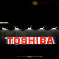 Toshiba Corp. apologized to shareholders Monday and said it would remove two directors. | REUTERS