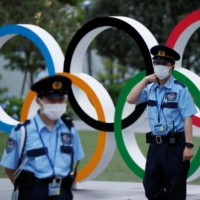 The central government is considering placing Tokyo under a quasi-state of emergency during the Olympics, after a number of health experts expressed concerns over a potential spike in COVID-19 cases. | REUTERS