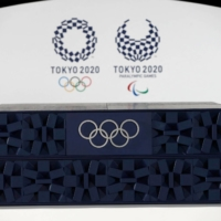 The podium to be used for the medal ceremonies at the Tokyo 2020 Olympics Games is seen during an event to mark 50 days to the opening ceremony, at Ariake Arena in Tokyo on June 3.