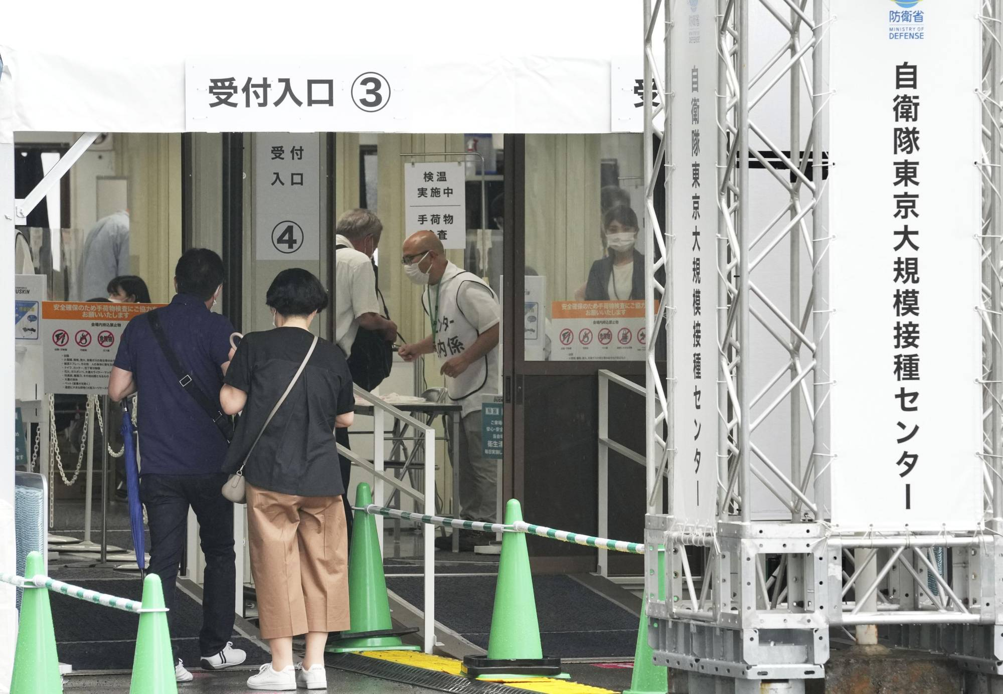 People visit the mass vaccination center run by the Self-Defense Forces in Tokyo on Monday. | KYODO