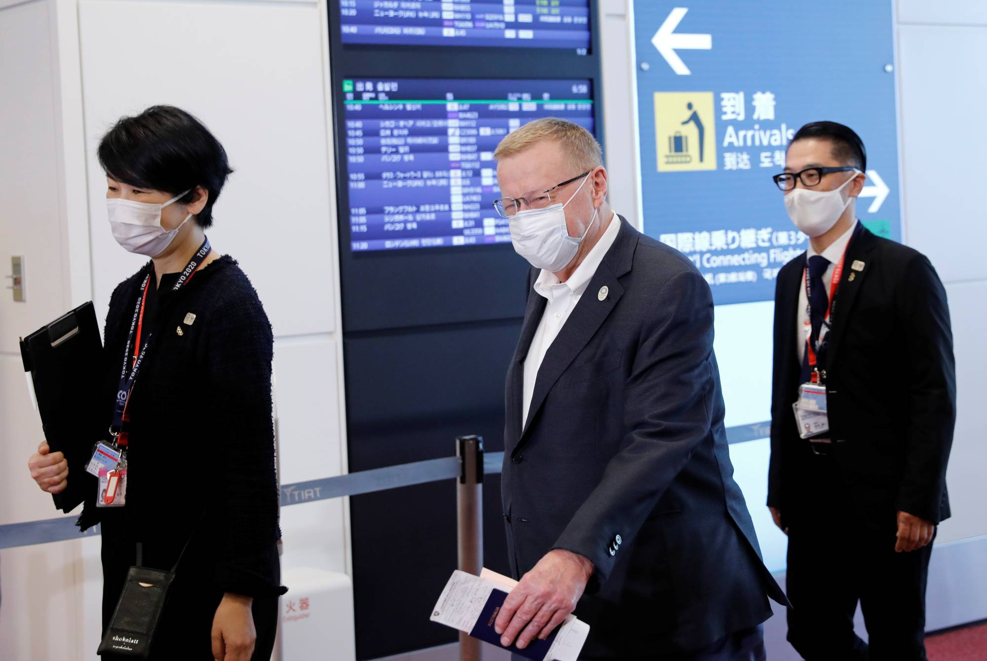 International Olympic Committee Vice President John Coates (center) arrives at Haneda Airport in Tokyo on Tuesday. | REUTERS