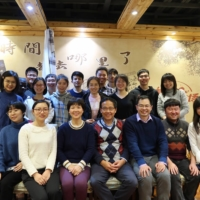 Dr. Shi Zhengli (third from left in the front row), sits with her fellow virologist Wang Linfa (fourth from left) and colleagues from the Wuhan Institute of Virology at a restaurant in Wuhan, China, on Jan. 15, 2020. Zhengli said in a rare interview that speculation about her lab in Wuhan was baseless, but China's habitual secrecy makes her claims hard to validate. | COURTESY OF WANG LINFA / VIA THE NEW YORK TIMES