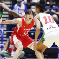 Naho Miyoshi led Japan in Thursday's series opener, with 14 points. | KYODO