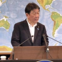 Foreign Minister Toshimitsu Motegi speaks at a news conference in Tokyo on Tuesday. | KYODO