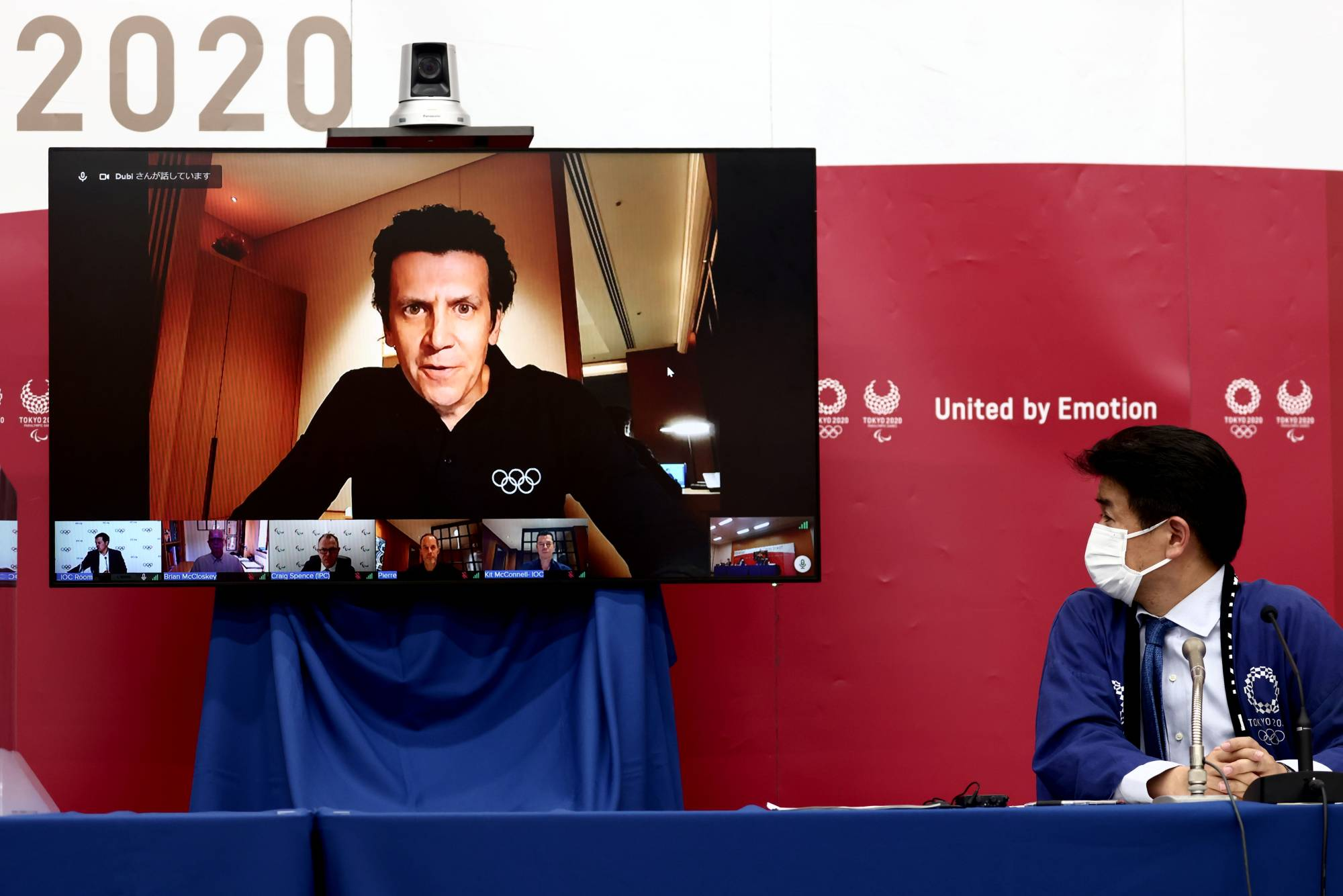 IOC Olympic Games Executive Director Christophe Dubi speaks as Tokyo 2020 Games Delivery Officer Hidemasa Nakamura looks on during a news conference for the presentation of the latest version of the Tokyo Olympics' so-called playbook in Tokyo on Tuesday. | POOL / VIA REUTERS