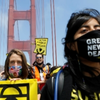Youth climate activists, who began their trek in Paradise, California, march across the Golden Gate Bridge in San Francisco on Monday.    REUTERS