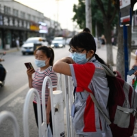 A bus stop in Beijing on Tuesday | AFP-JIJI
