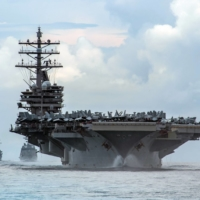 The USS Ronald Reagan aircraft carrier operates in the Philippine Sea in July last year. In a sign of rising tensions, Beijing deployed 28 Chinese fighter jets, bombers and other aircraft over waters south of Taiwan hours after the Reagan carrier group sailed into the South China Sea. | U.S. NAVY / VIA THE NEW YORK TIMES