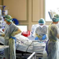 A COVID-19 patient receives treatment at a hospital in Darmstadt, Germany.  | REUTERS