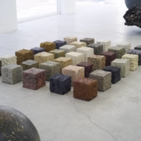 A display of large clay cubes at architect Bijoy Jain's Mino Soil 'Material' exhibition in Tokyo showcases the variety of colors that can be produced from clay soil mined in Gifu Prefecture.    YURIKA KONO