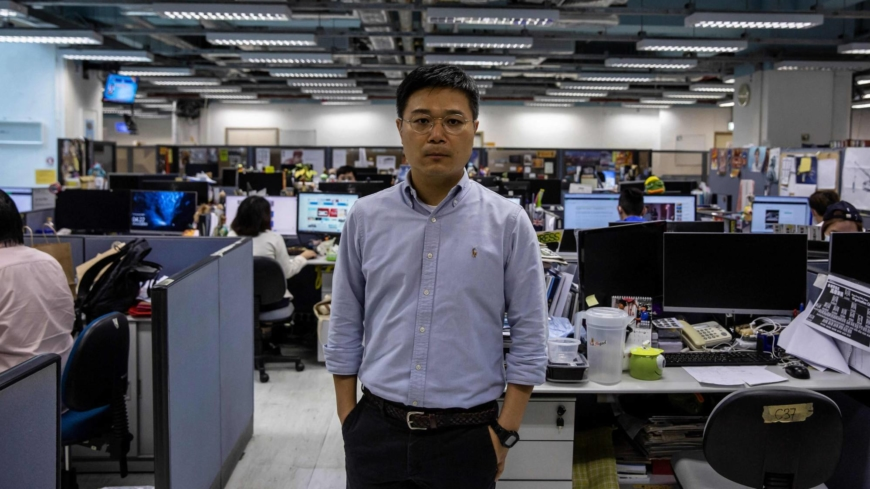 Hong Kong arrests Apple Daily staff using security law