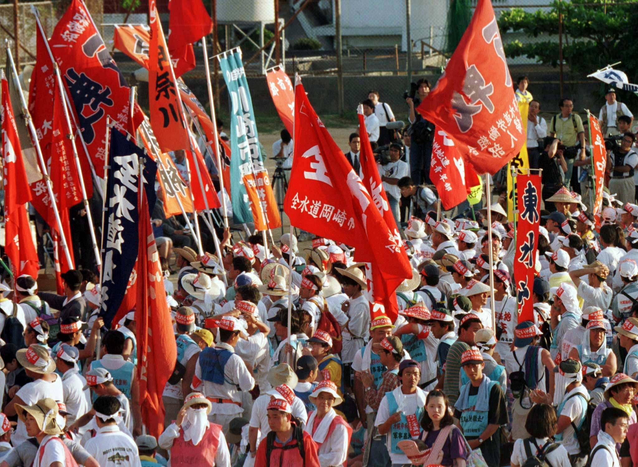 Anti-base demonstrators gather near the U.S. Futenma Air Base in Okinawa on May 15, 1997, to protest against the U.S. military presence on the 25th anniversary of Okinawa's 1972 reversion to Japanese rule.  | REUTERS