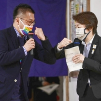 Gon Matsunaka (left), head of Pride House Tokyo Legacy, greets Seiko Hashimoto, president of the Tokyo 2020 Organising Committee, at the LGBTQ community center in Tokyo on April 27.   KYODO